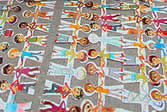 photo of paper chain dolls