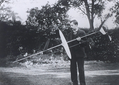 Frederick Lanchester with one of his model gliders used to make aerodynamic measurements, 1894.