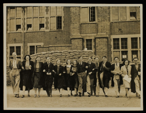 MS310/43 A2038/2 Students in front of sandbagged protected University College buildings, 1939