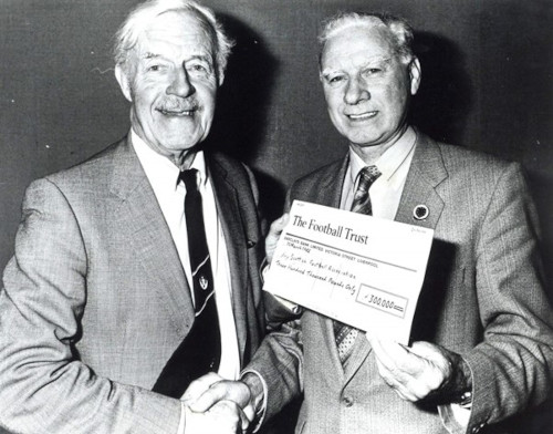 Chester presenting a Football Trust cheque to the Scottish Football Association. Photograph shows Chester, Ernie Walker (Secretary of the Scottish Football Association).
